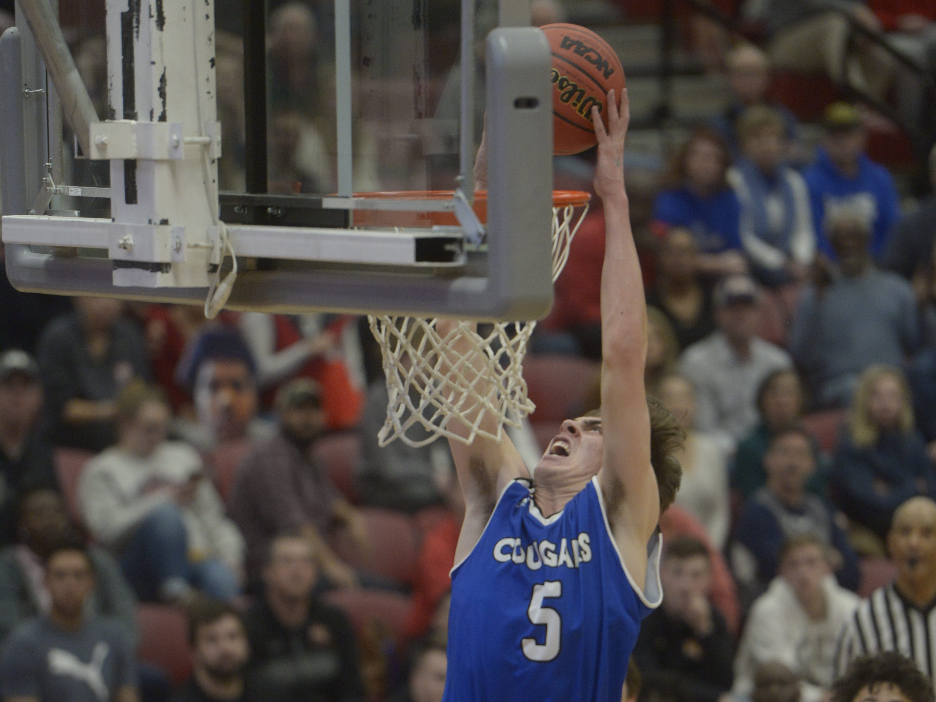 Resurrection Christian guard Reece Johnson attempts a dunk during a Class 3A quarterfinals game against Manual at the University of Denver on Thursday, March 7, 2019.