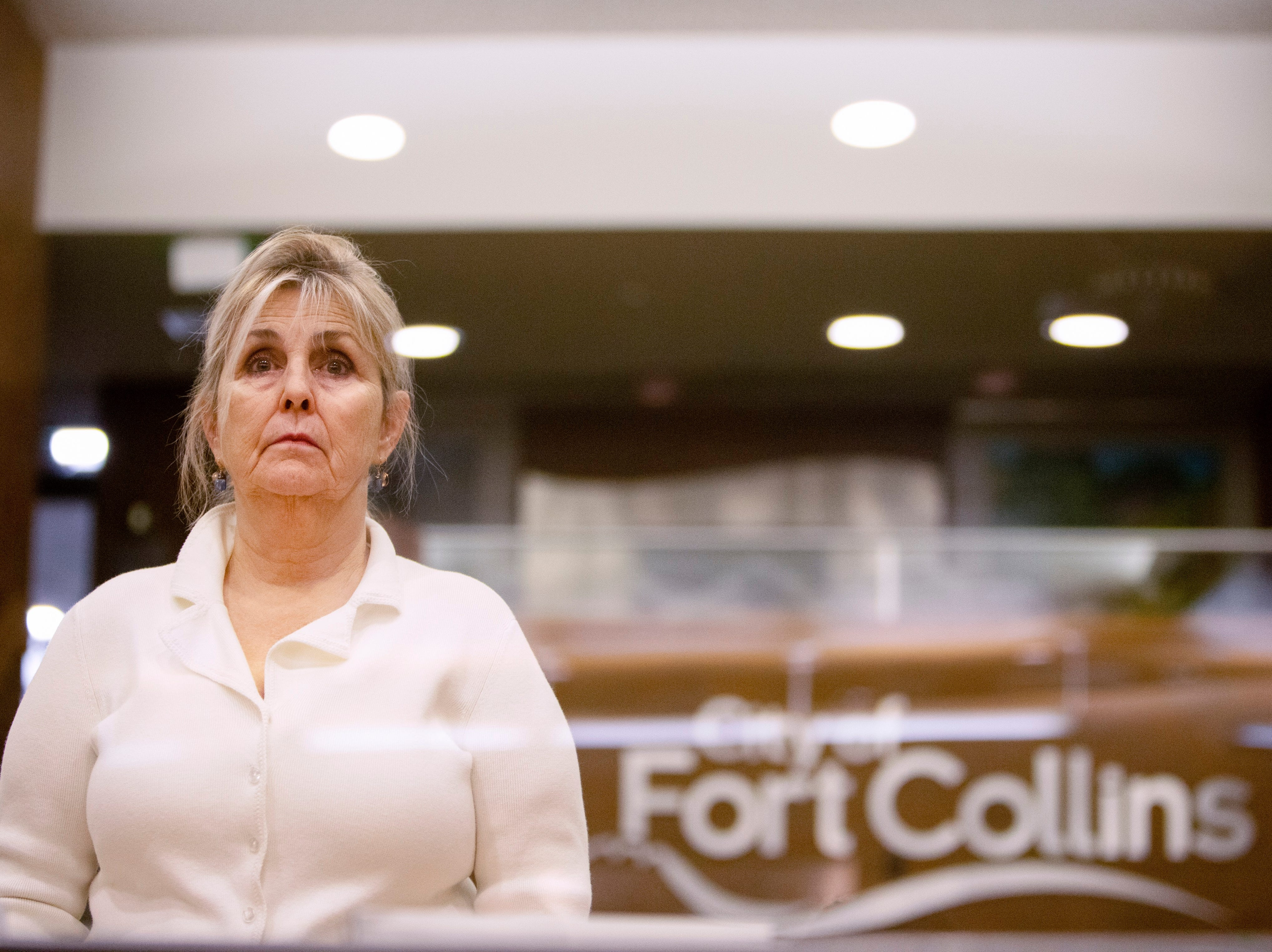 City Council candidate Susan Holmes watches as the first tier of candidates discuss issues facing the city during the forum hosted by The League of Women Voters of Larimer County at City Hall on March 6.