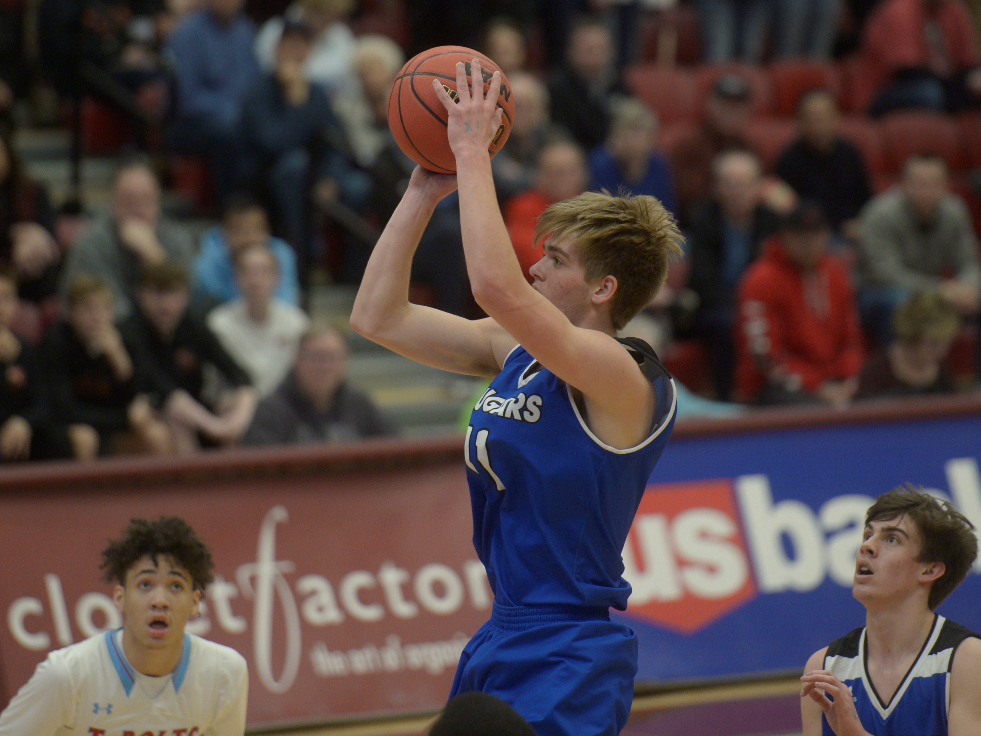 Resurrection Christian basketball forward Reade Lindgren shoots during a Class 3A quarterfinals game against Manual at the University of Denver on Thursday, March 7, 2019.