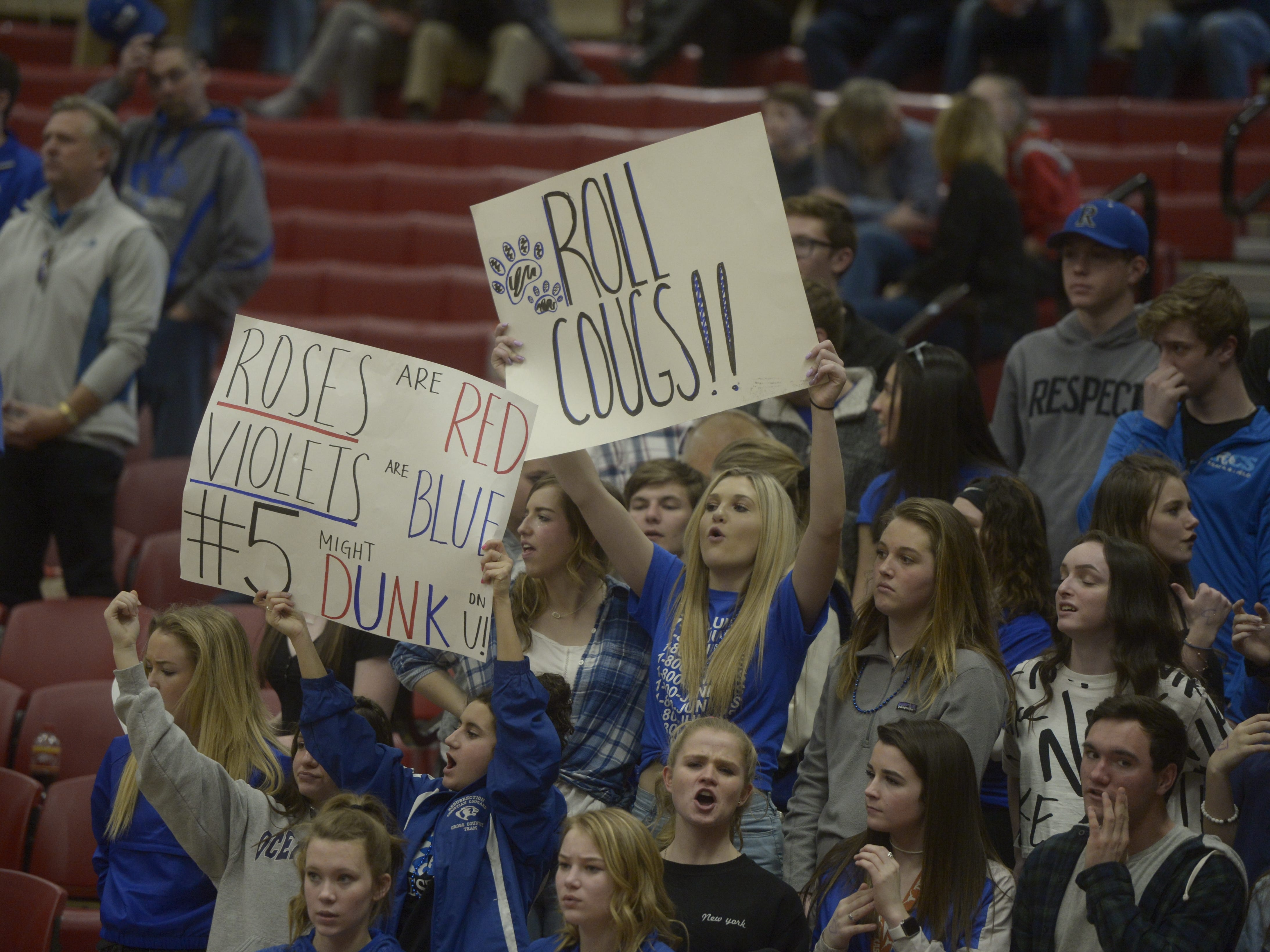 Resurrection Christian basketball fans cheer during a Class 3A quarterfinals game against Manual at the University of Denver on Thursday, March 7, 2019.