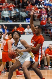 Lehigh's Ronnail Tape looks to the hoop against Crestview at the Class 7A boys basketball state championships at the RP Funding Center in Lakeland.