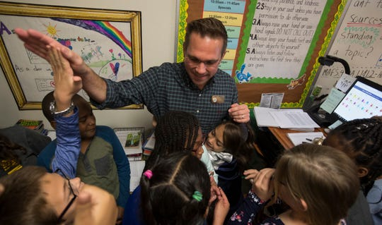 James Rose gets surrounded by his students after finding out he is a 2019 Golden Apple winner. He teaches 4th grade at Ray V. Pottorf Elementary in Fort Myers.