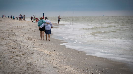 A couple was on the beach Tuesday morning. Even on a cloudy morning the beach is filled with walkers, fishermen, and shell hunters. Six months ago people were asked to stay off the beaches and even rebook their trips to the area.