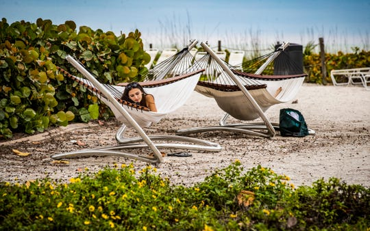 Bella Carson, 15, of Virginia Beach, enjoys the morning on the hammocks, beach side of the Inn. She is visiting for the week with her mother during her spring break. Island Inn general manager, Chris Davison, is cautiously optimistic about our area's water woes heading in the right direction, especially with a new governor and a changing of the guard at the South Florida Water Management District. He lost a lot of business last summer but is back to 100 percent occupancy during high season.