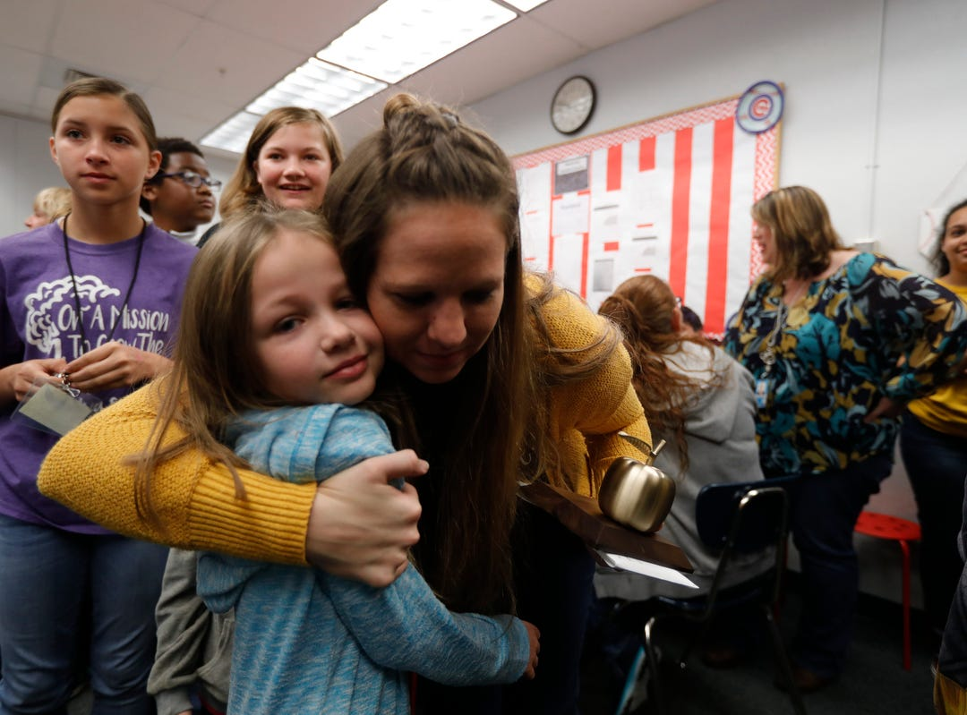 The Alva School teacher Stacey Anderson was surprised Friday morning, March 8, 2019, as she was awarded the Golden Apple in front of her students. The 2019 Golden Apple Teacher Recognition Awards were presented by The Foundation for Lee County Public Schools. This year's winners also included: Courtney Black of Allen Park Elementary; Kristina Caudill of Heights Elementary; Kristina Gale of Gulf Elementary; Amanda Rose of Dunbar High School; and James Rose of Ray V. Pottorf Elementary.