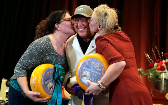 Richard Guggisberg, center, of Guggisberg Cheese in Ohio celebrates a first-place victory at the U.S. Championship Cheese Contest with Kim Rabuck, left, and Marieke Penterman, right, of Marieke Gouda, which took second and third places, on Thursday at the KI Convention Center in Green Bay.
