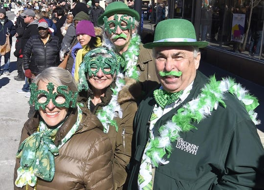 Decked out with Irish spirit to watch the 2018 Sturgeon Bay St. Patrick's Day Parade are William and Gordonna Komassa of Brookfield, back, and Al and Bee Heckendorf of Thiensville.