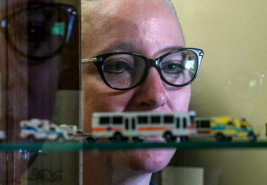 """Sheila Kaiser looks at toy ambulances her husband James gave her as the two both worked as paramedics in Anderson County. Kaiser said her husband James took his life in 2016. """"We made the mistake of making a rule in our marriage that we leave work at work and not talk about it at home."""""""