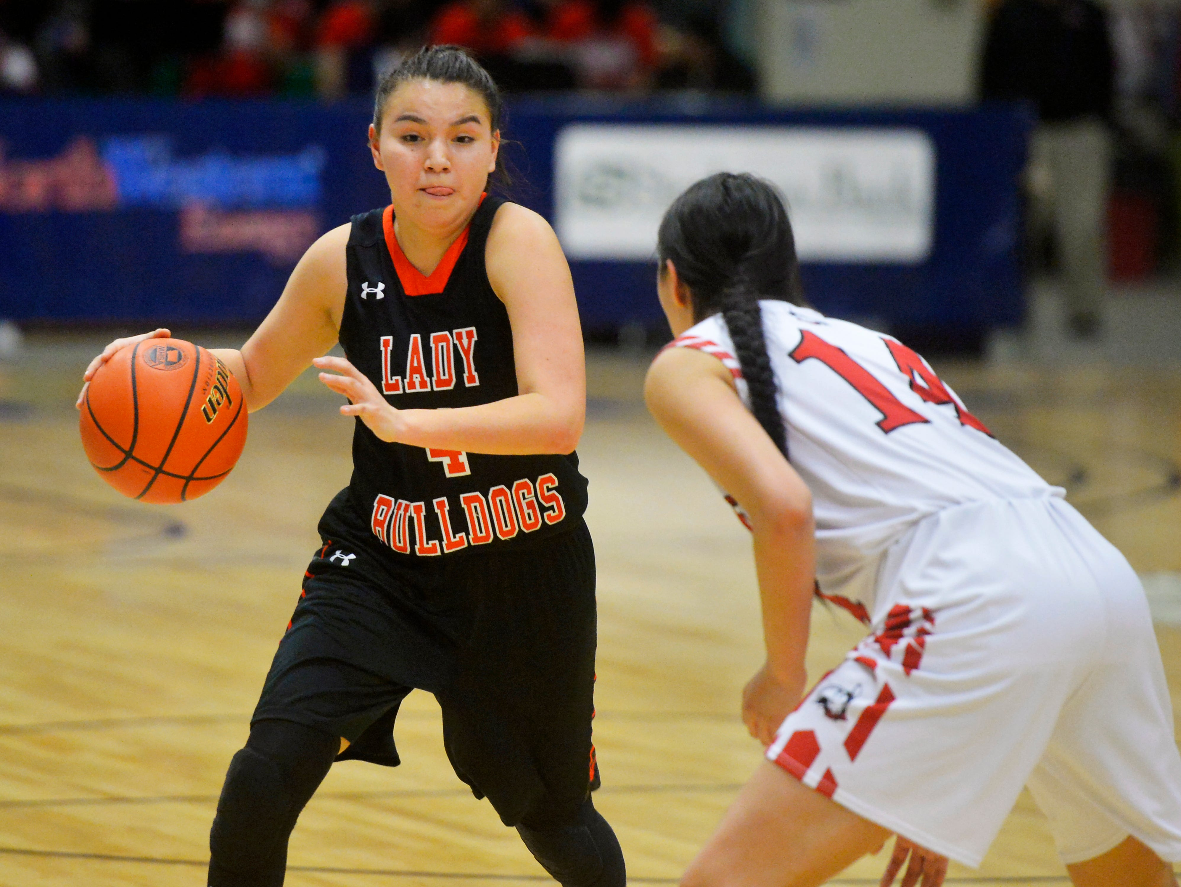 Hardin's Mashaya Alden attempts to dribble passed Browning's Kelsey Mad Plume during the Class A State Basketball Tournament in the Four Seasons Arena, Thursday.