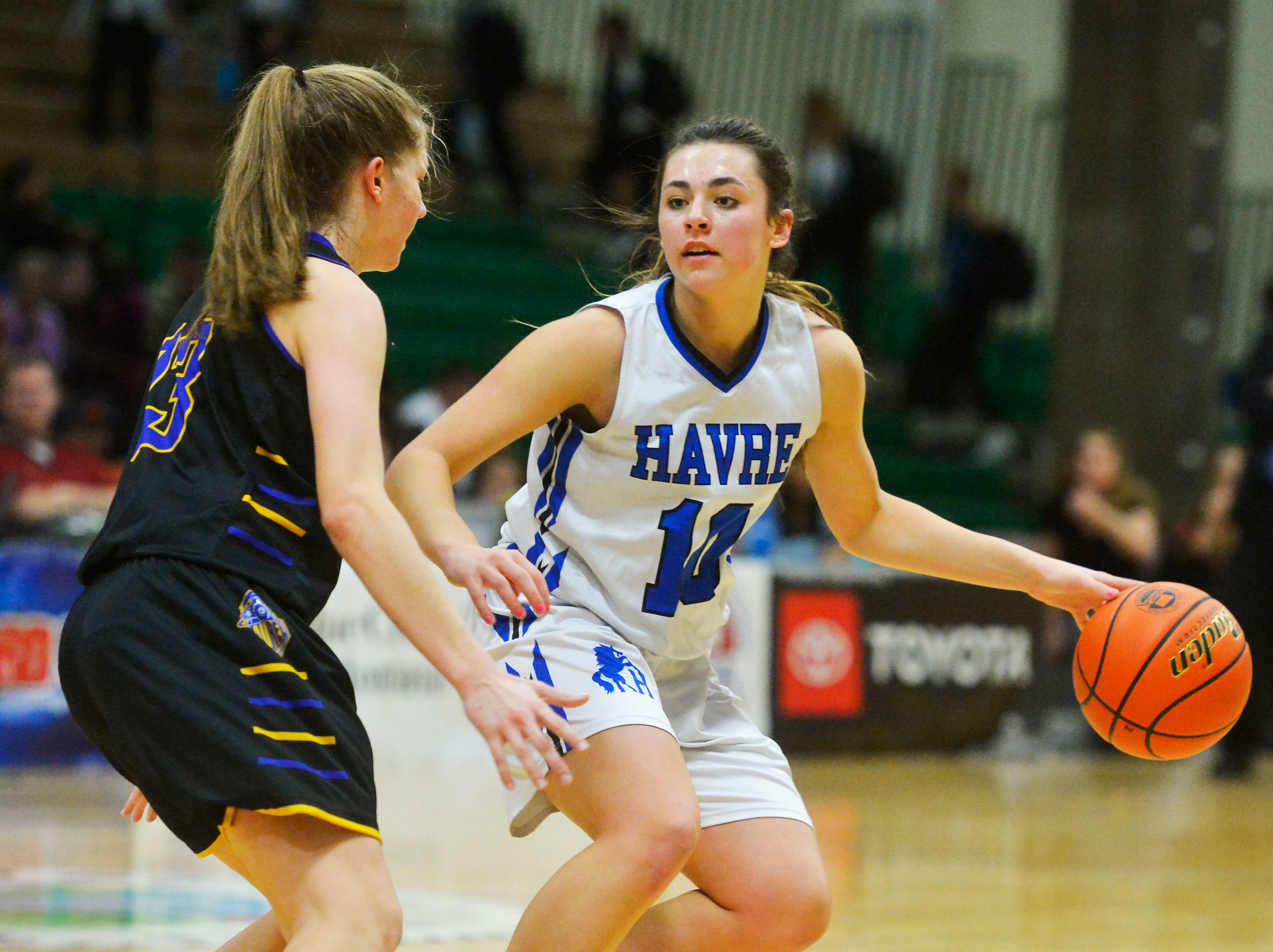 Havre's Kyndall Keller looks for an opening in the defense as Laurel's Gracey Willis defends during the semifinal round of the State Class A Basketball Tournament in the Four Seasons Arena, Friday.