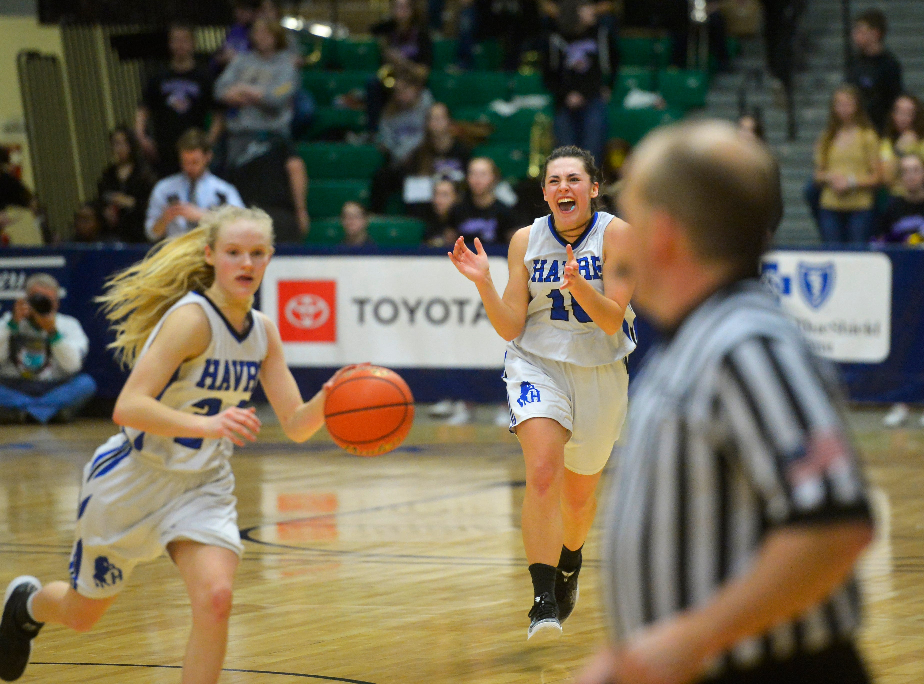 Havre's Kyndall Keller celebrates as the final seconds tick off the clock in their semifinal victory over Laurel at the State Class A Basketball Tournament in the Four Seasons Arena, Friday.