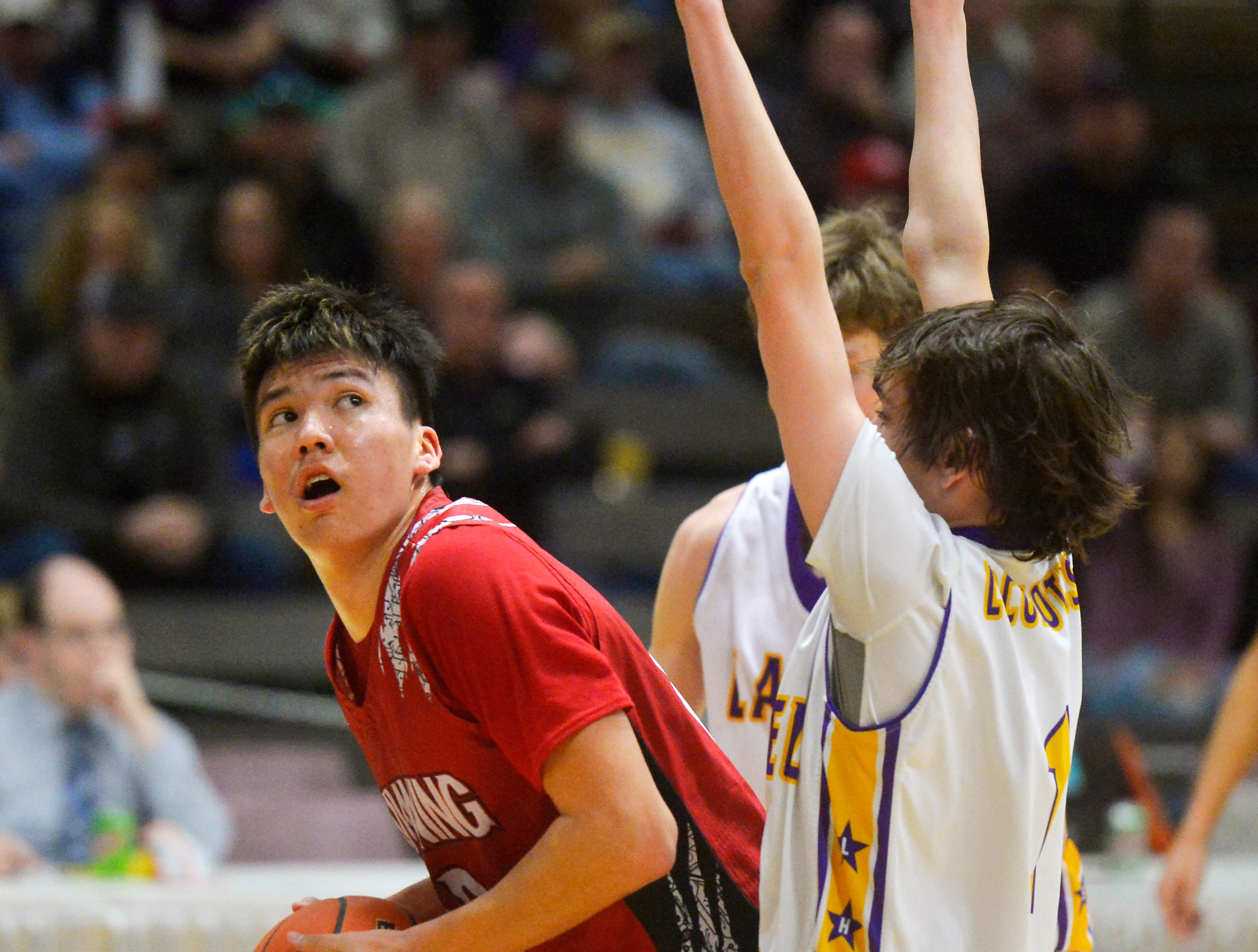 Browning's Riley Spoonhunter eyes the basket during Friday's game against Laurel during the State Class A Basketball Tournament in the Four Seasons Arena.