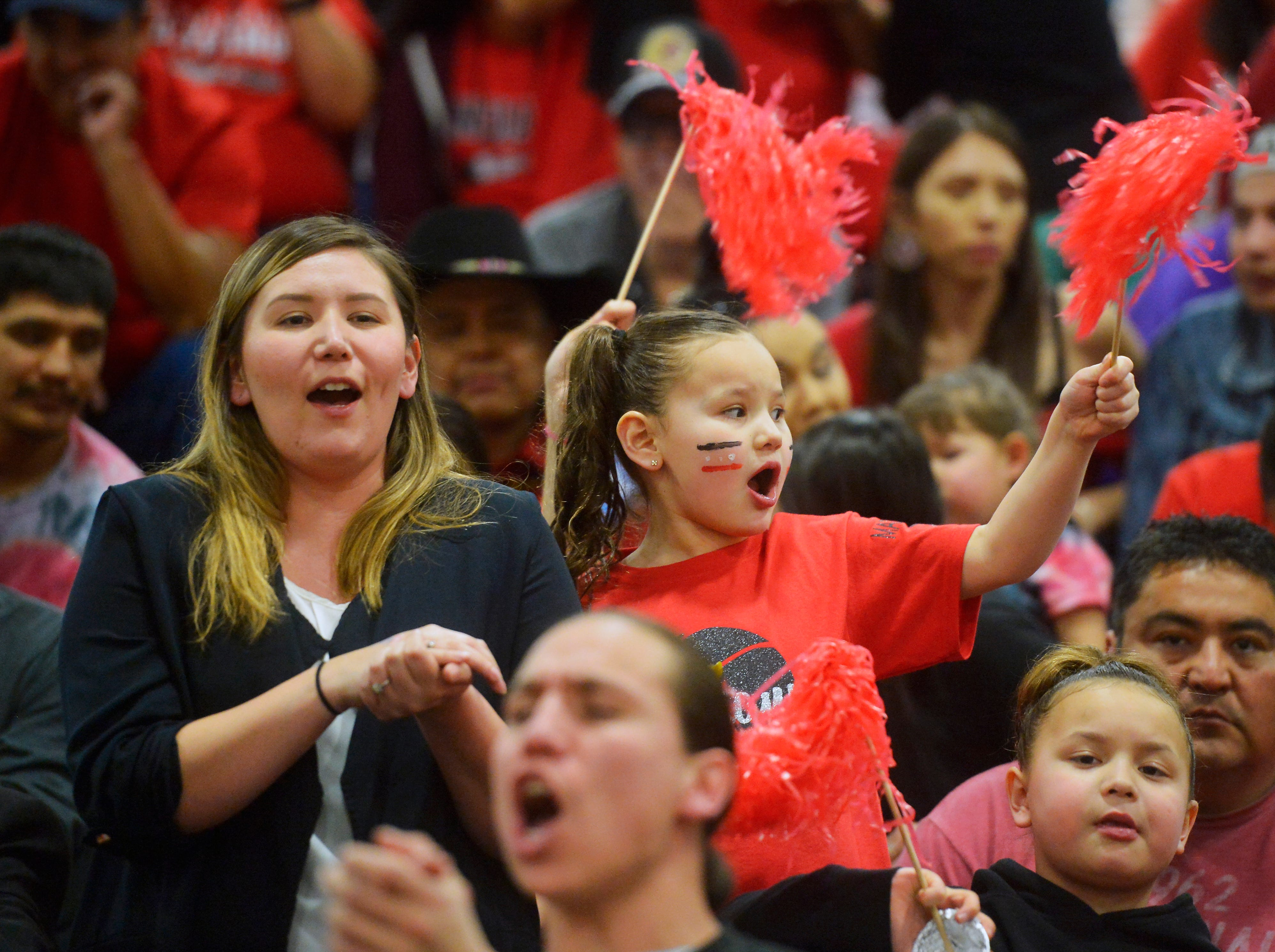 Browning fans cheer on their team during the Class A Boys State Basketball Tournment in the Four Seasons Arena.