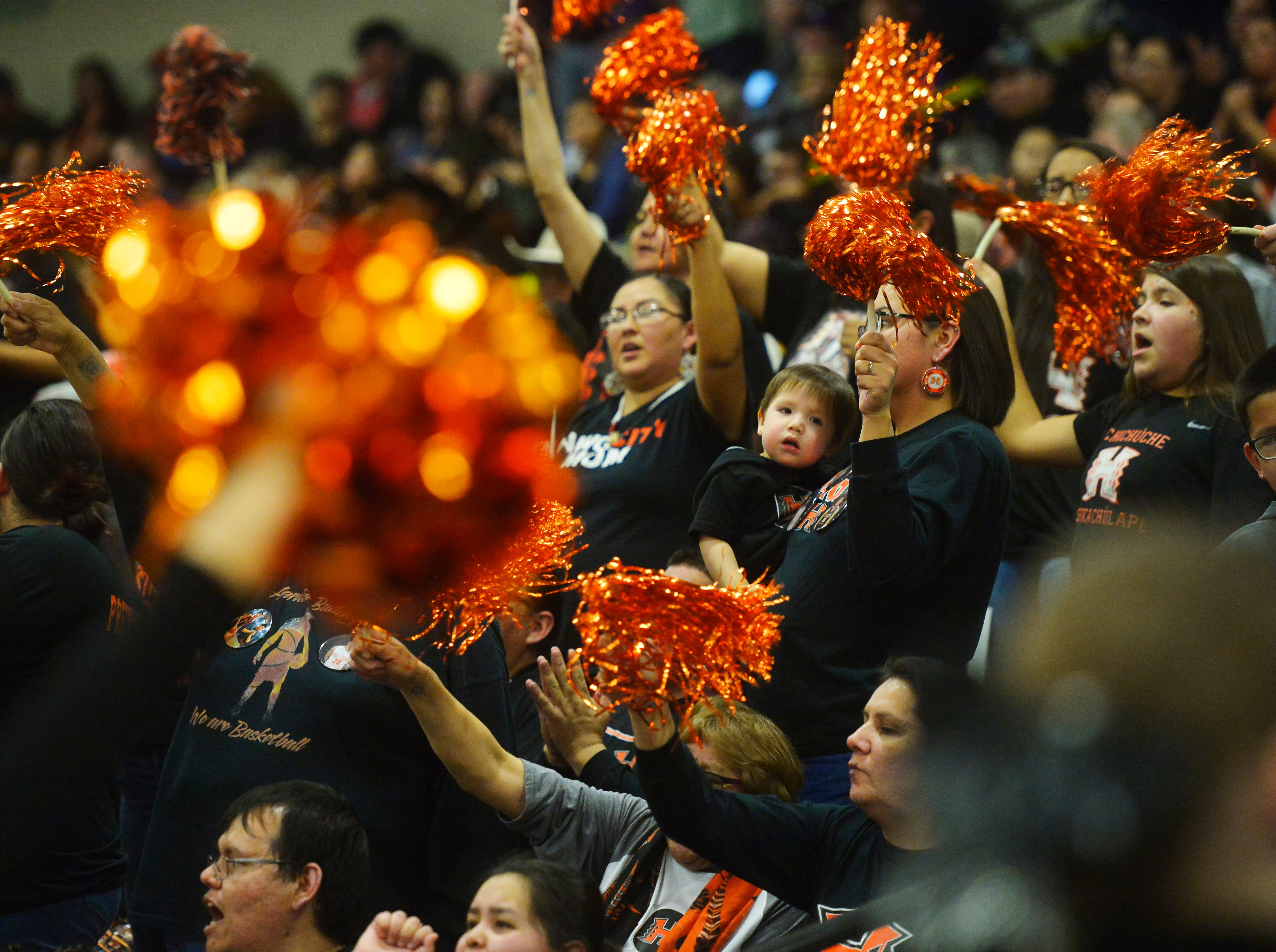 Hardin fans cheer during Thursday's game against Browning at the Class A State Basketball Tournament in the Four Seasons Arena.