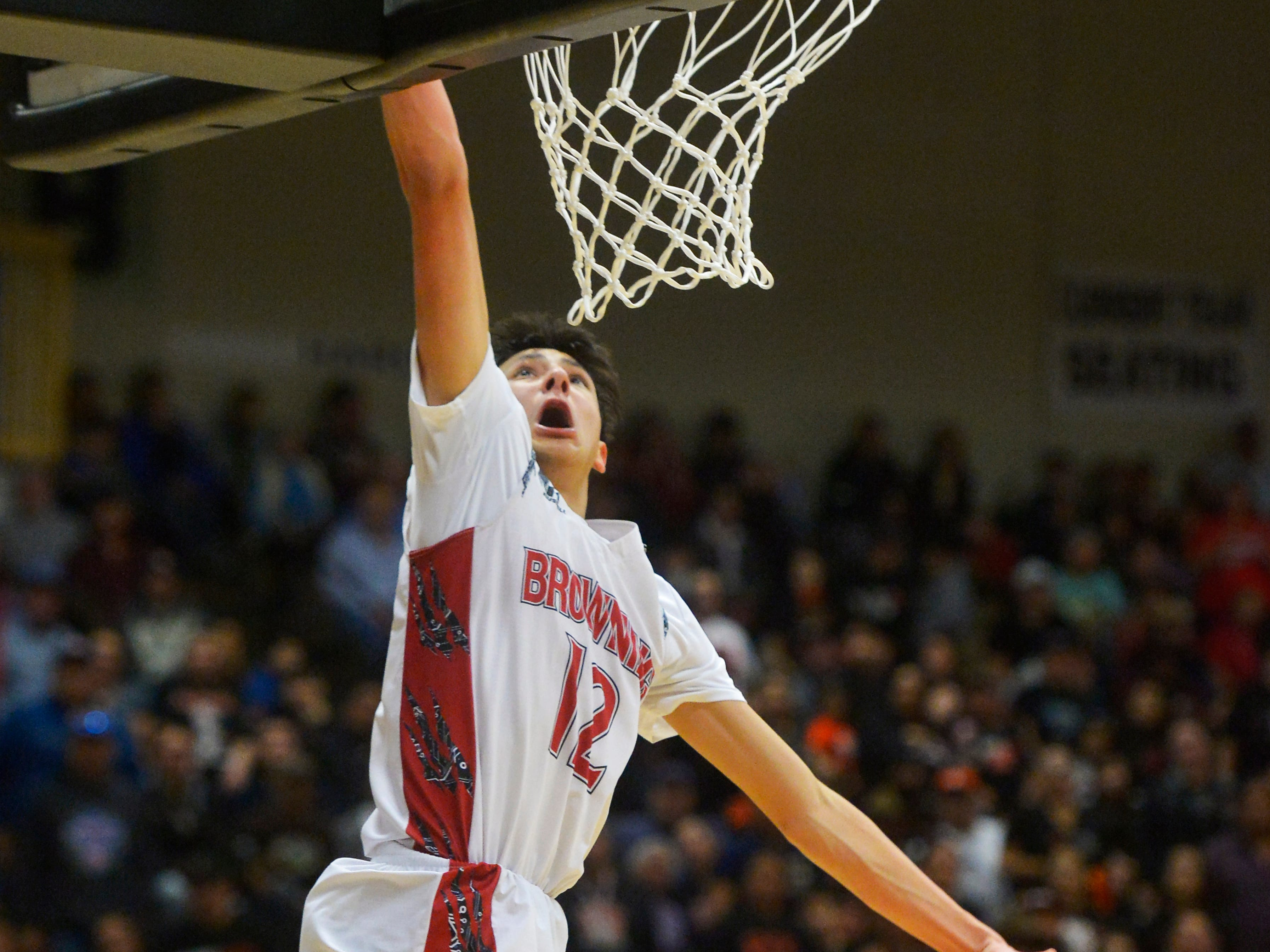 Browning's Ethan Running Crane lays the ball up at the rim during Thursday's game against Hardin at the Class A State Basketball Tournament in the Four Seasons Arena.