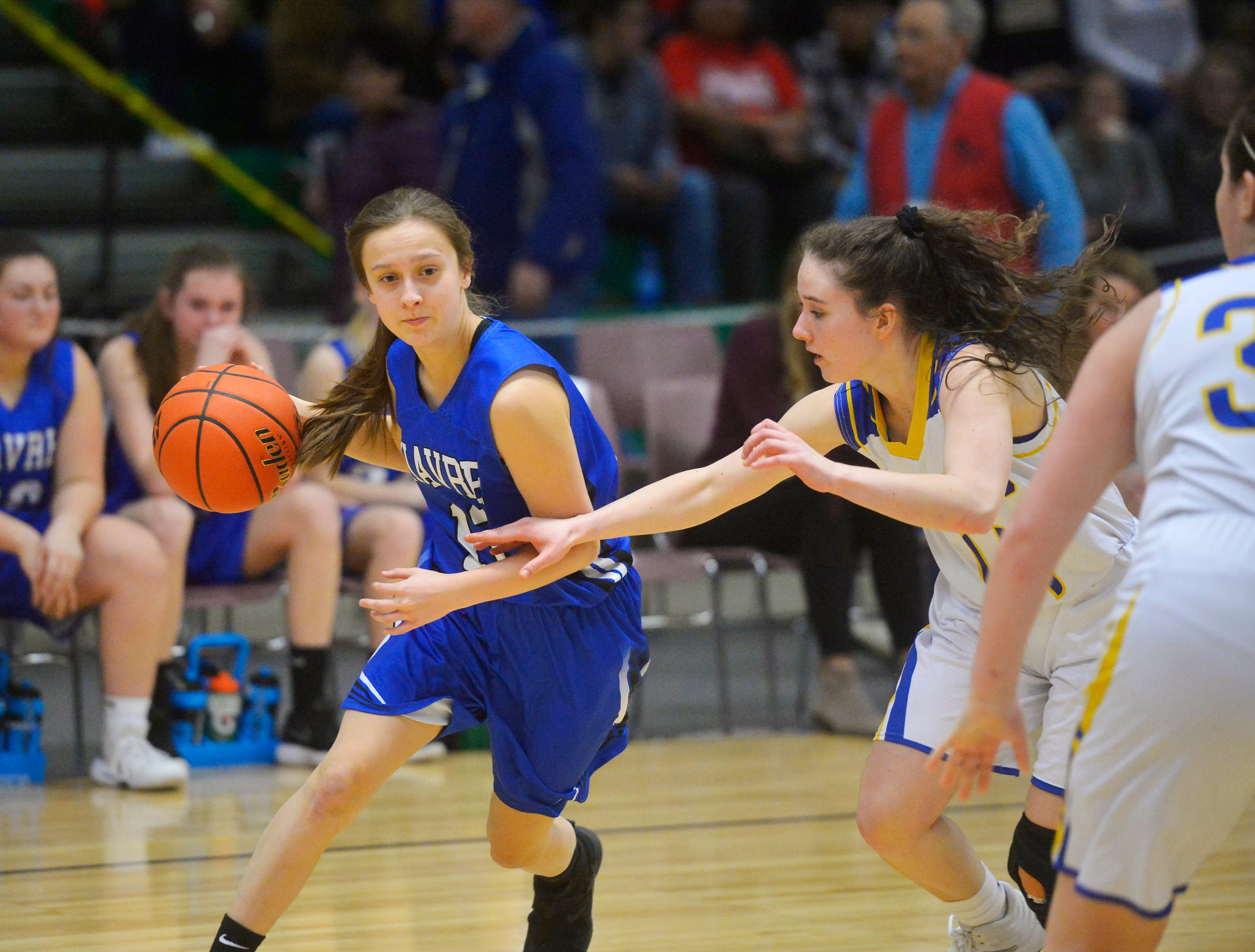 Havre's Kylie Walker drives to the basket as Libby's Emma Gruber defends during the Class A State Basketball Tournament in the Four Seasons Arena, Thursday.