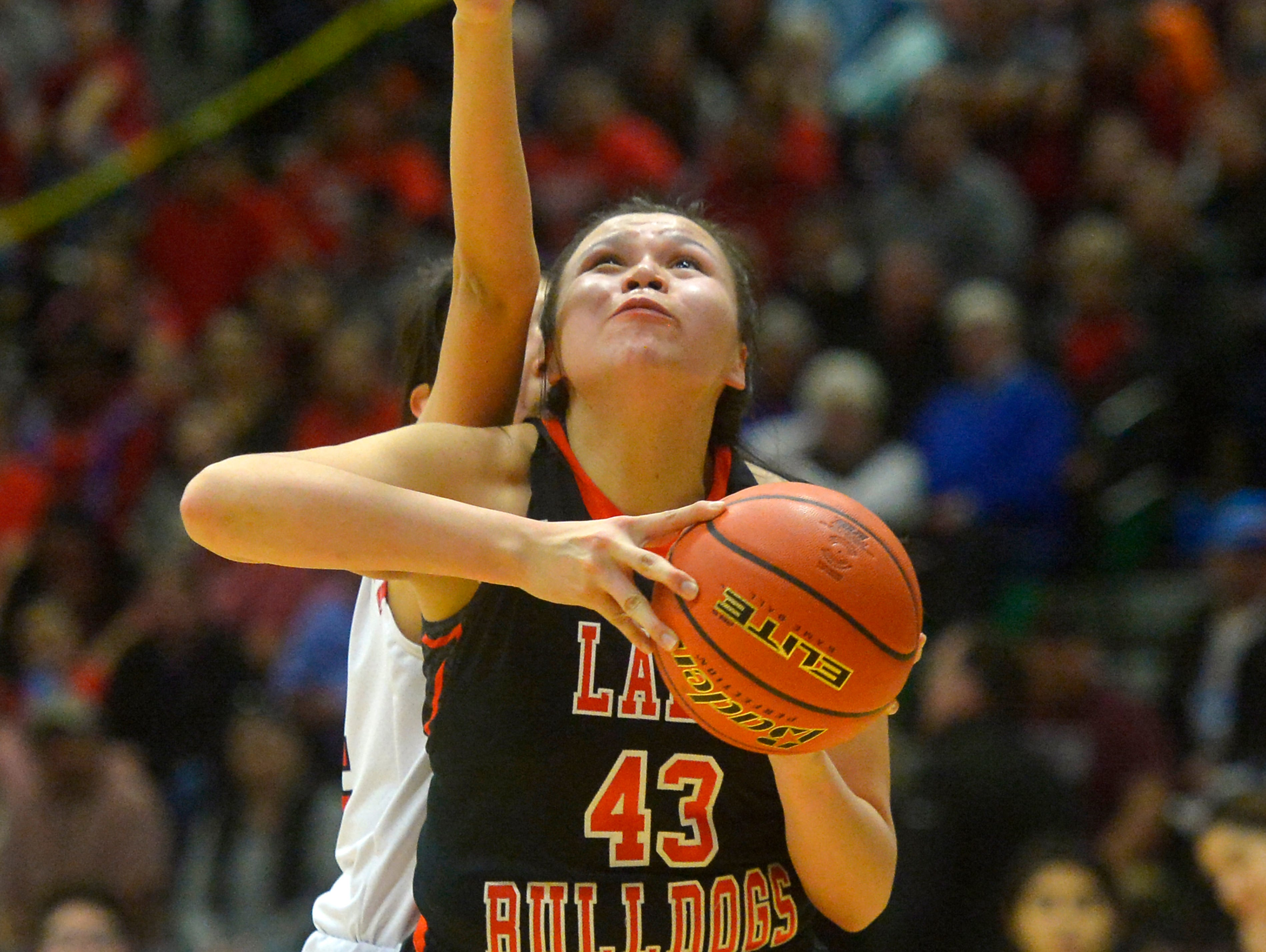 Hardin's Marie Five eyes the basket during the Class A State Basketball Tournament in the Four Seasons Arena, Thursday.