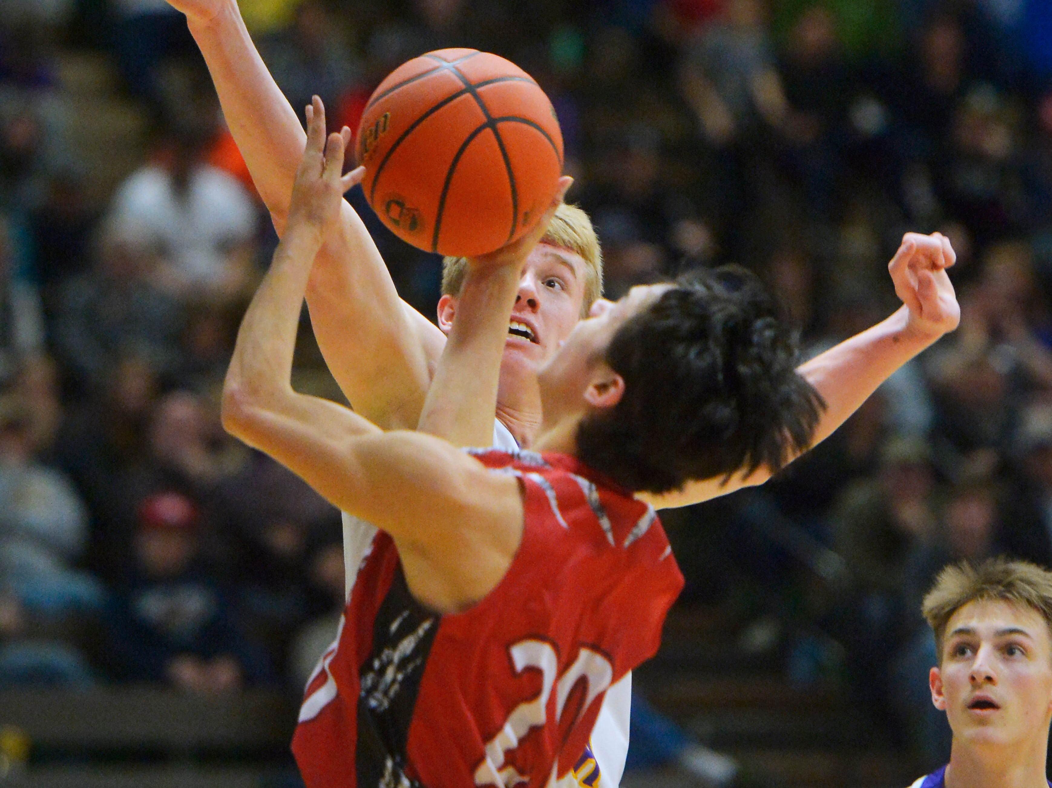Laurel's Colter Bales defends the basket as Browning's CJ Smith attempts a shot in the consolation bracket of the State Class A Basketball Tournament on Friday.