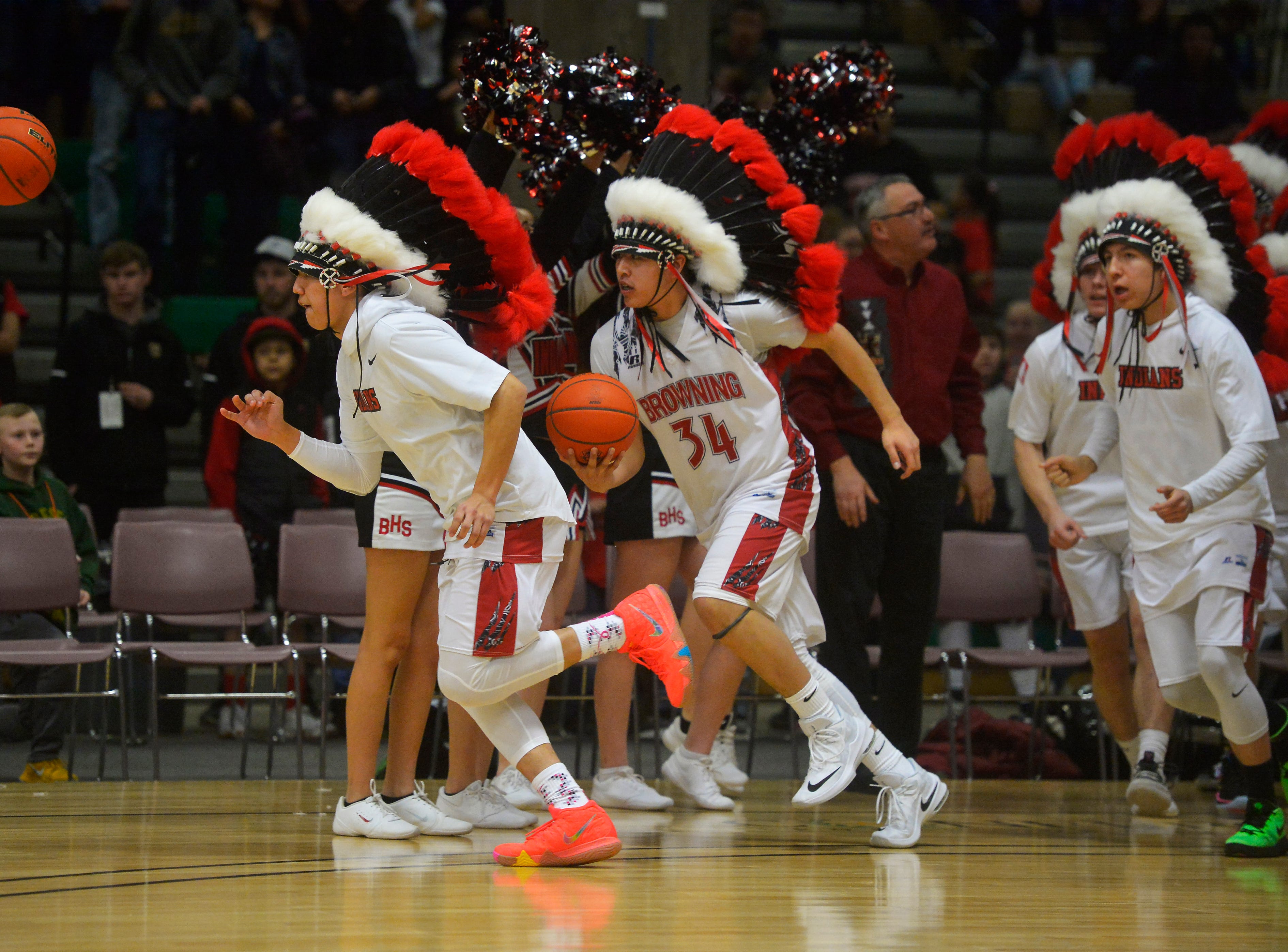 The Browning boys basketball is introduced before their game against Hardin during the Class A State Basketball Tournament in the Four Seasons Arena, Thursday.