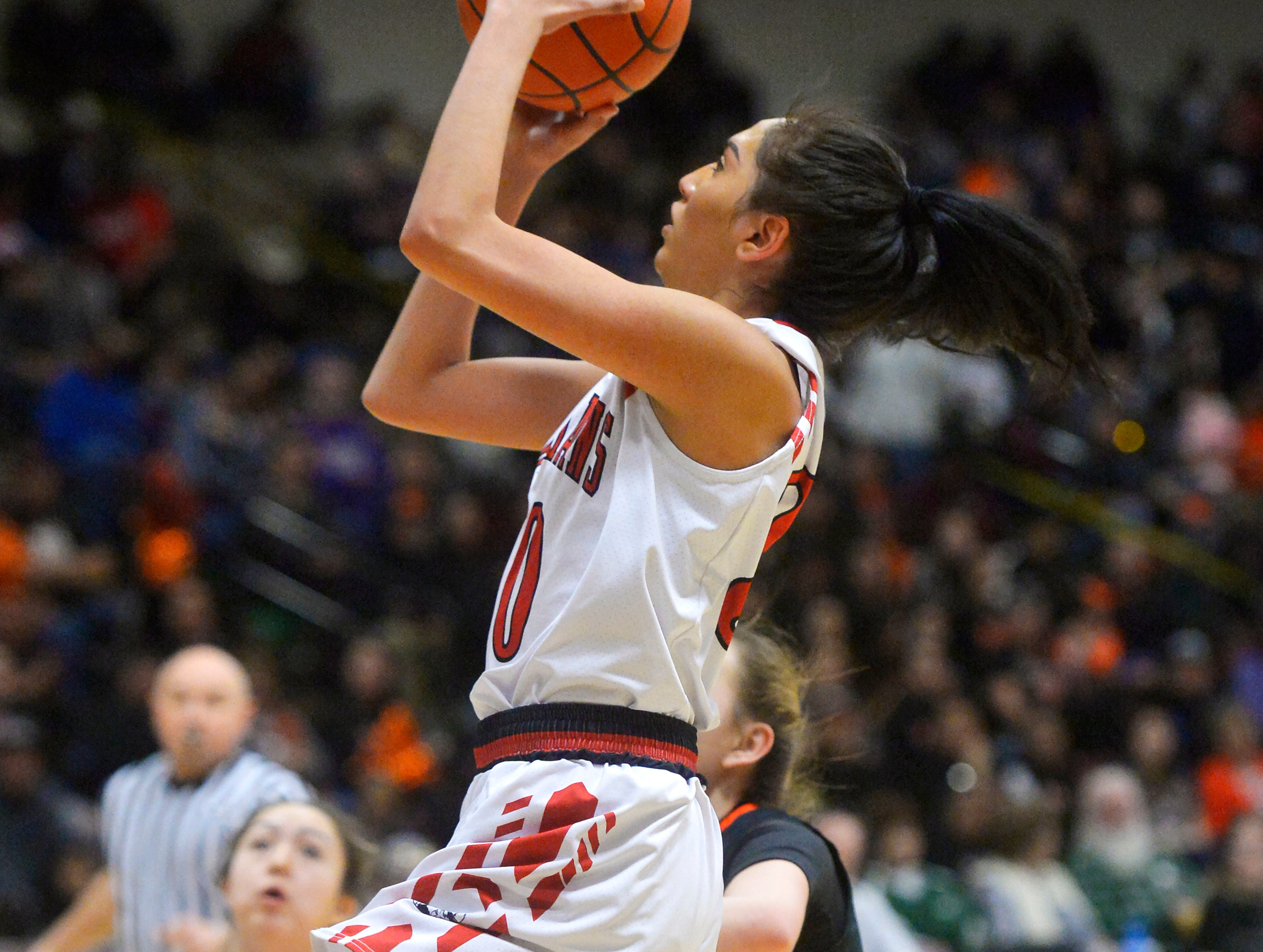 Browning's Dulci Skunkcap attempts a shot during the Class A State Basketball Tournament in the Four Seasons Arena, Thursday.