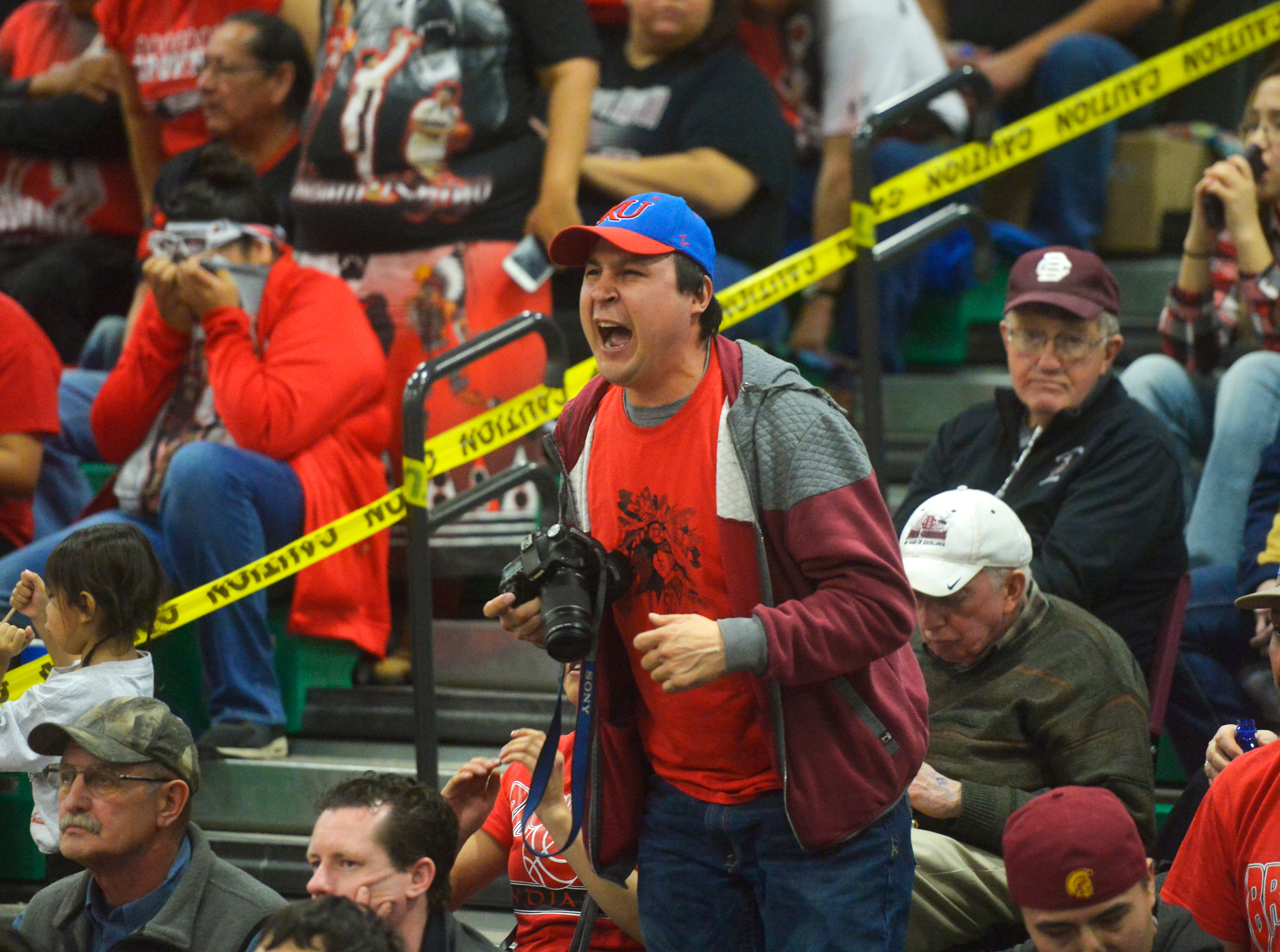 A Browning fans yells for a call from the referees during the Class A Boys State Basketball Tournament in the Four Seasons Arena.