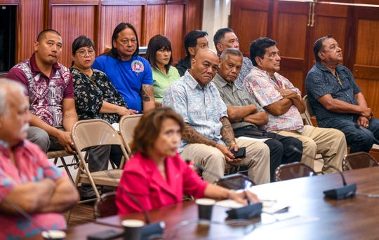 Island village mayors and others, listen as Jackie Marati, representing Keep Guam Good, express her opposition to Legislative Bill 29, as she testifies before lawmakers at the Guam Congress Building in Hagåtña on Friday, March 8, 2019. The measure authorizes the Mayors Council of Guam to justify and establish rules and regulations, related to games of chance being allowed at the Liberation Day Carnival, and any other fair or carnival, that the governor has issued a proclamation for.