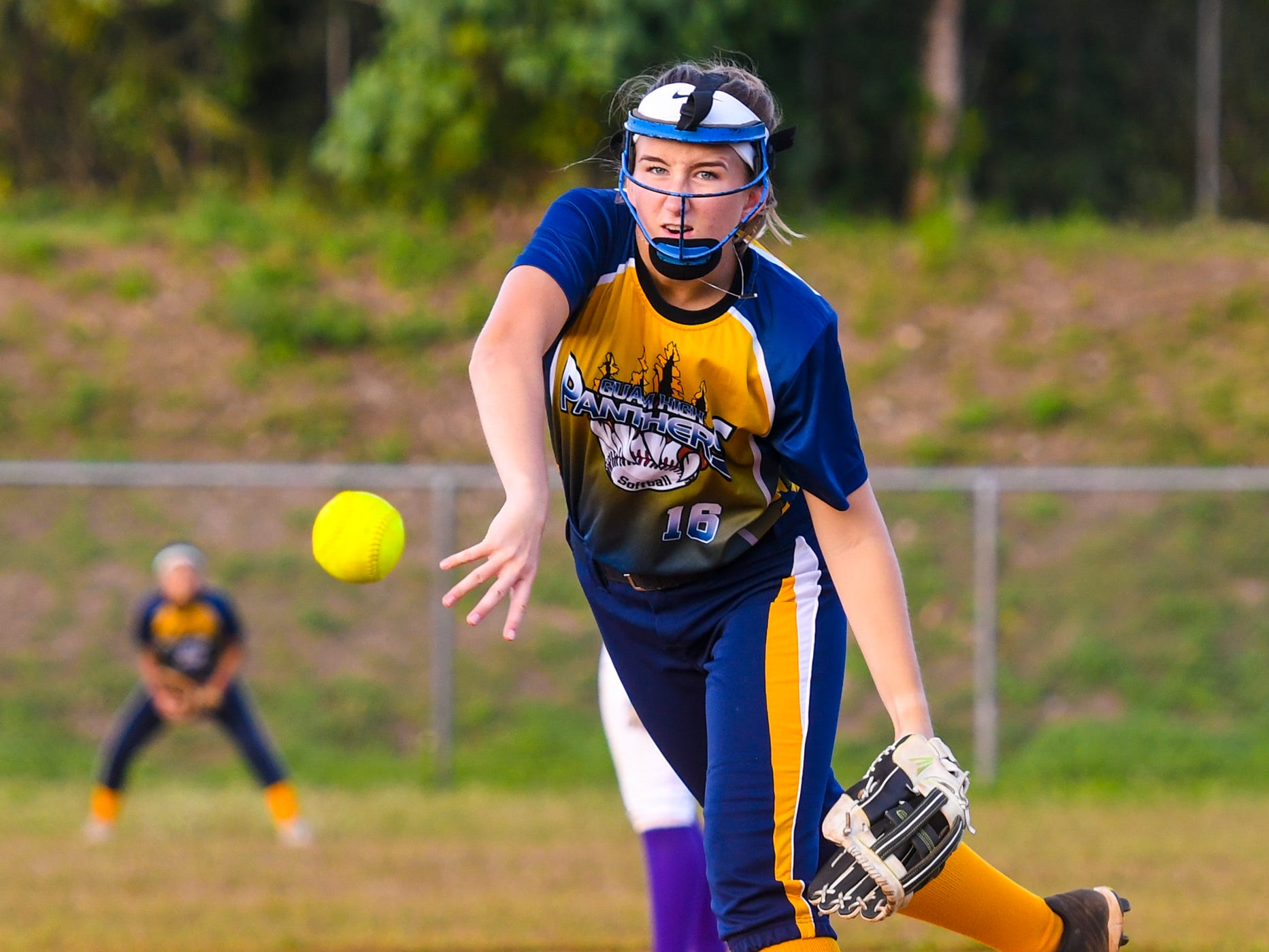 Guam High School Panthers' pitcher Alexis Blyth tosses one over the plate during an IIAAG girls softball game with the George Washington High School Geckos on the diamond at Okkodo High School in Dededo on Thursday, March 7, 2019.