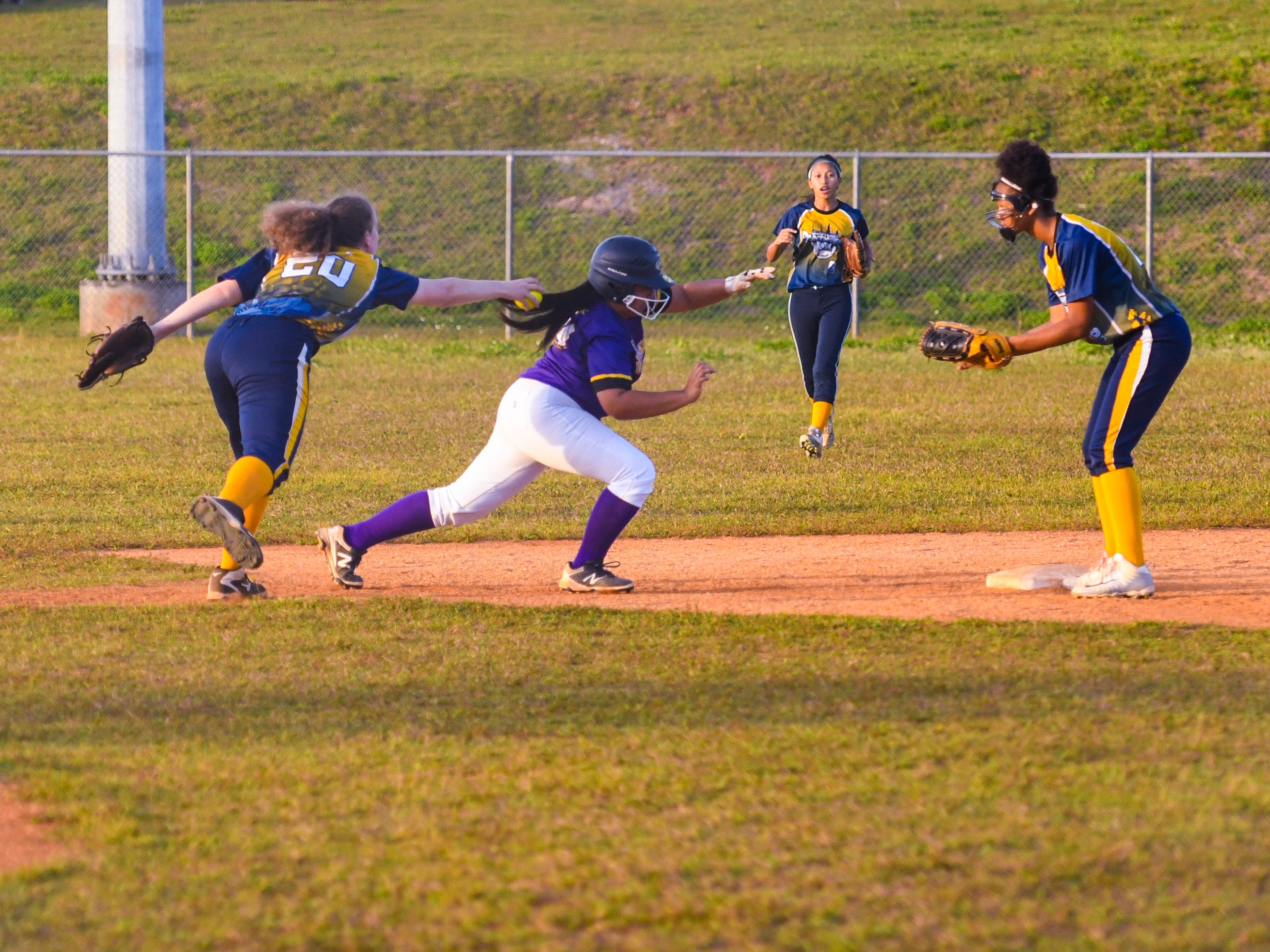 The Guam High School Panthers took on the challenge of the George Washington High School Geckos in IIAAG girls softball action on the diamond at Okkodo High School in Dededo on Thursday, March 7, 2019.