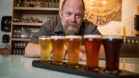 Award-winning head brewer Mike Converse showcases six craft beer flavors at The Guam Brewery Tap House in this file photo.