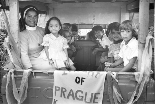 In this Feb. 1974 file photo, Sister Benedict accompanies children from various kindergartens in the back of Fr. Sams' pickup during a march commemorating Catholic Education Week.