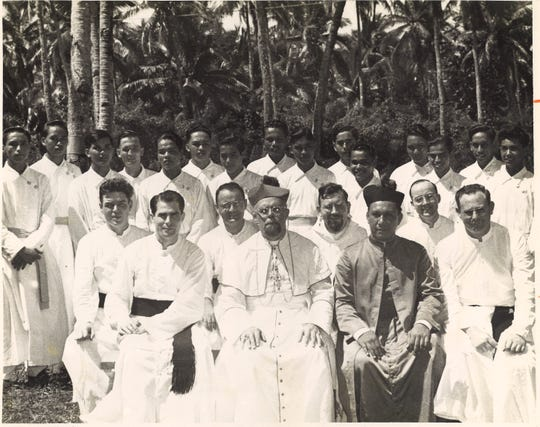 The first class of Father Duenas Memorial School pose for a photograph in 1948. Bishop Apollinaris Baumgartner, center, and Msgr. Oscar Calvo and Father Curcil Langheim posed with the boys and five original Stigmatine Fathers. Fathers Antonio Cruz, Ben Martinez and Daniel Cristobal were in this class.