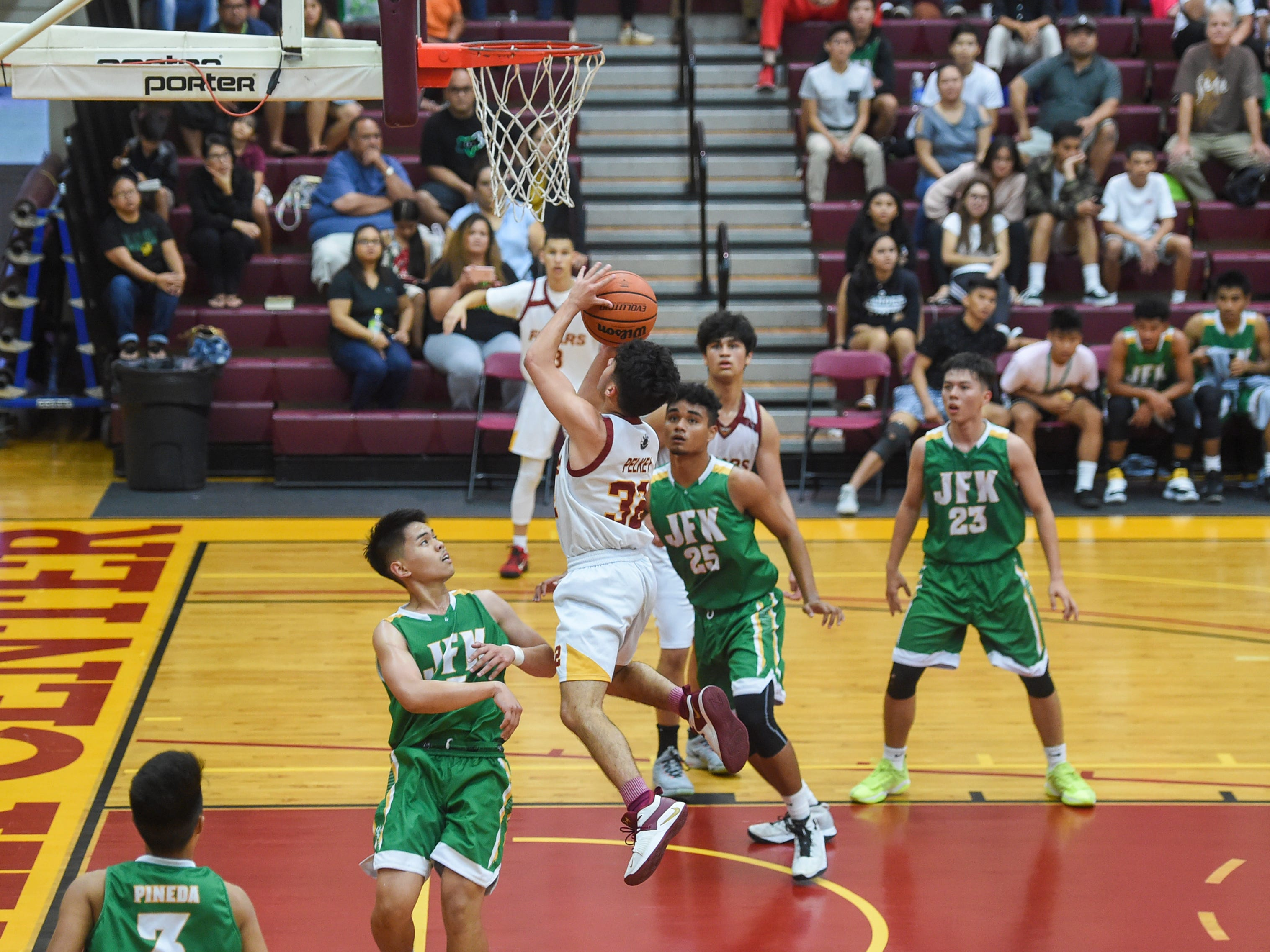 The Father Duenas Friars edged out the John F. Kennedy Islanders in a 64-62 overtime win for their IIAAG Boys' Basketball playoff game at the FD Phoenix Center, March 8, 2019.
