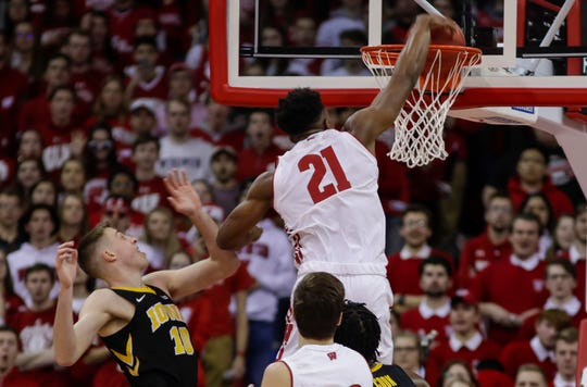 Wisconsin's Khalil Iverson dunks over Iowa's Joe Wieskamp during the first half of Thursday's game at the Kohl Center.