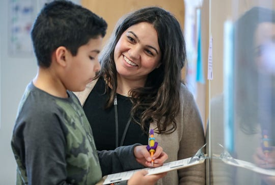 From right, Angie Durbin, a special education teacher at Noblesville East Middle School, works with sixth grader Ulises Sanchez, Monday, March 4, 2019. Noblesville School district is leading the state in efforts to place students with special learning needs in general education classrooms and teach the same concepts as their peers.