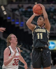 Leigha Brown of the Nebraska Cornhuskers works against Dominique Oden of the Purdue Boilermakers, Nebraska vs. Purdue, Women's Big Ten Tournament, Bankers Life Fieldhouse, Indianapolis, Thursday, March 7, 2019.