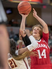 Ali Patberg of the Indiana Hoosiers shoots against defense by Jasmine Brunson of the Minnesota Golden Gophers, Minnesota vs. Indiana, Women's Big Ten Tournament, Bankers Life Fieldhouse, Indianapolis, Thursday, March 7, 2019. Indiana won 66-58