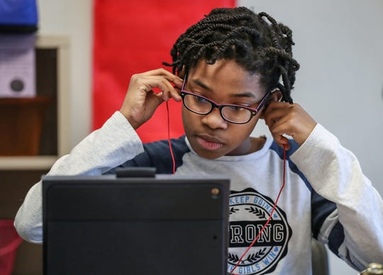 Sixth grader Camille Rollins works puts in headphones to complete her classwork at Noblesville East Middle School in Noblesville, Ind., Monday, March 4, 2019. Noblesville School district is leading the state in efforts to place students with special learning needs in general education classrooms and teach the same concepts as their peers.