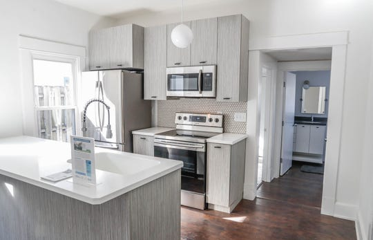 A newly remodeled home with an open kitchen on Cruft Street is part of an affordable home ownership program for artists.