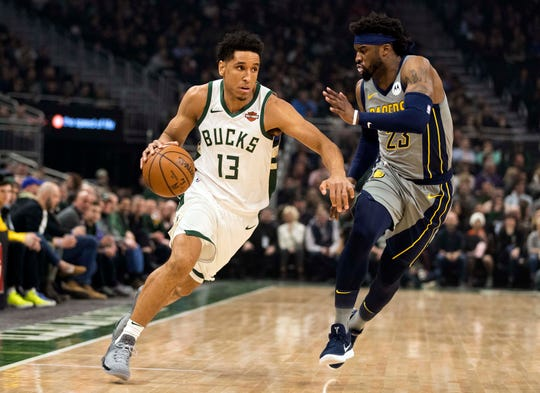 Mar 7, 2019; Milwaukee, WI, USA; Milwaukee Bucks guard Malcolm Brogdon (13) drives for the basket against Indiana Pacers guard Wesley Matthews (23) during the first quarter at Fiserv Forum.