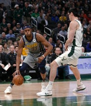 Indiana Pacers' Myles Turner (33) drives to the basket against Milwaukee Bucks' Ersan Ilyasova during the first half of an NBA basketball game Thursday, March 7, 2019, in Milwaukee.