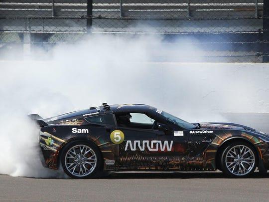 Sam Schmidt executes a celebratory doughnut in his semi-autonomous car after racing Mario Andretti at Indianapolis Motor Speedway in 2017.