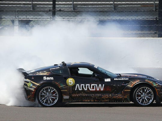 Sam Schmidt executes a celebratory doughnut in his semi-autonomous car after racing Mario Andretti at Indianapolis Motor Speedway in 2017.