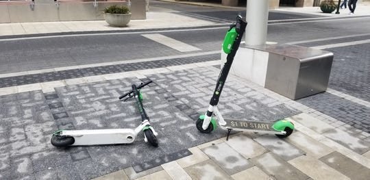 Lime scooters sit on a street in Indianapolis. In Denver, electric scooters hit the city's streets late last year and this month the city released data it has gathered about their usage.