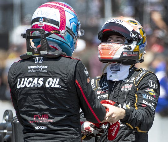 Friends and competitors  Robert Wickens (6),left, and James Hinchcliffe  greeted one another on Carb Day at the Indianapolis Motor Speedway in 2018.