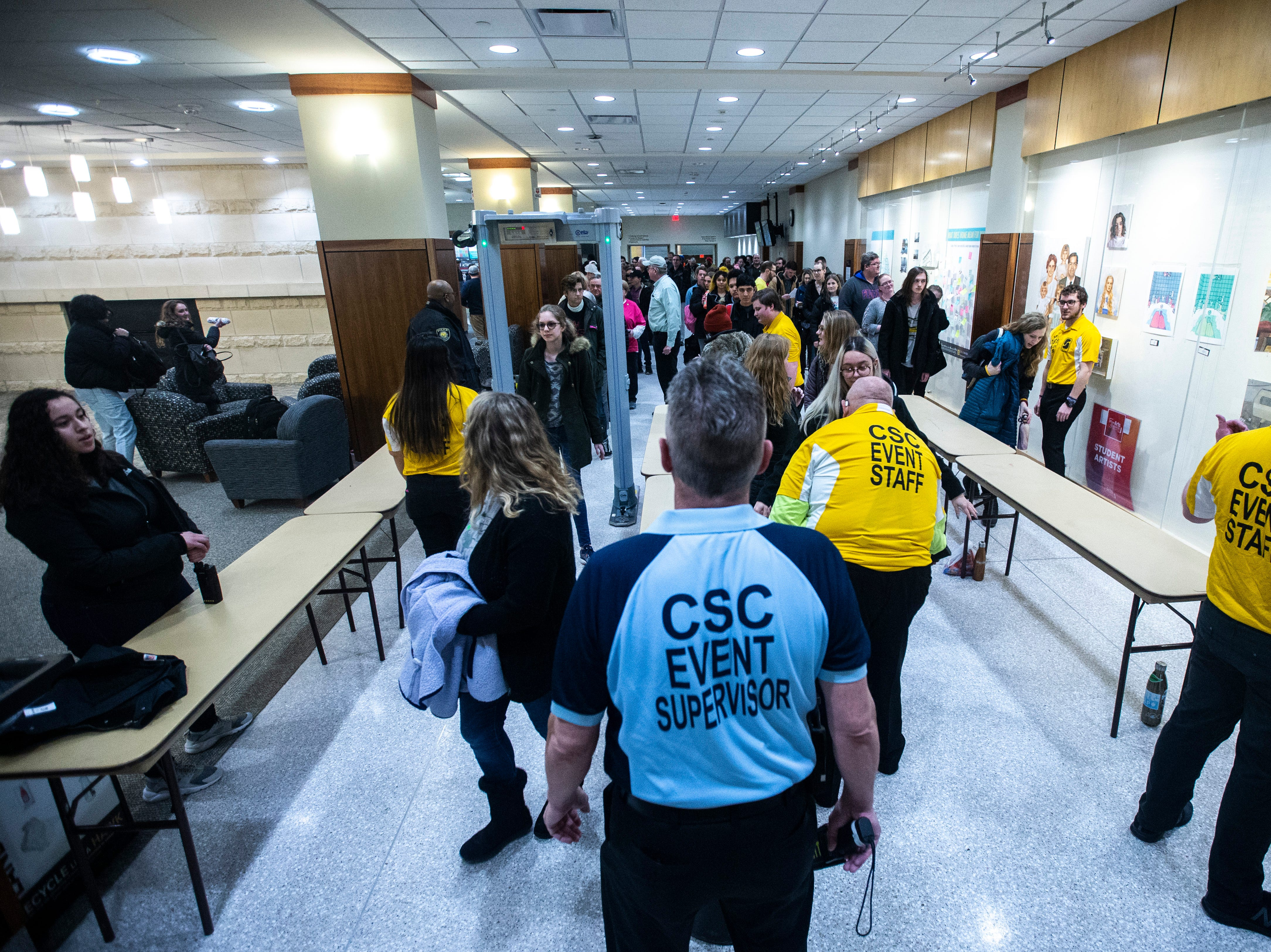 CSC security screen guests before U.S. Sen. Bernie Sanders, I-VT, speaks at an event during his first trip to the state ahead of the caucus, Friday, March 8, 2019, at the Iowa Memorial Union on the University of Iowa campus in Iowa City, Iowa.