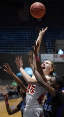 Pine Grove's Loren Elliott (25) shoots in a sea of arms against Simmons in the finals of the MHSAA C Spire State Basketball Championships at the Mississippi Coliseum in Jackson, Miss., on Thursday, March 7, 2019.