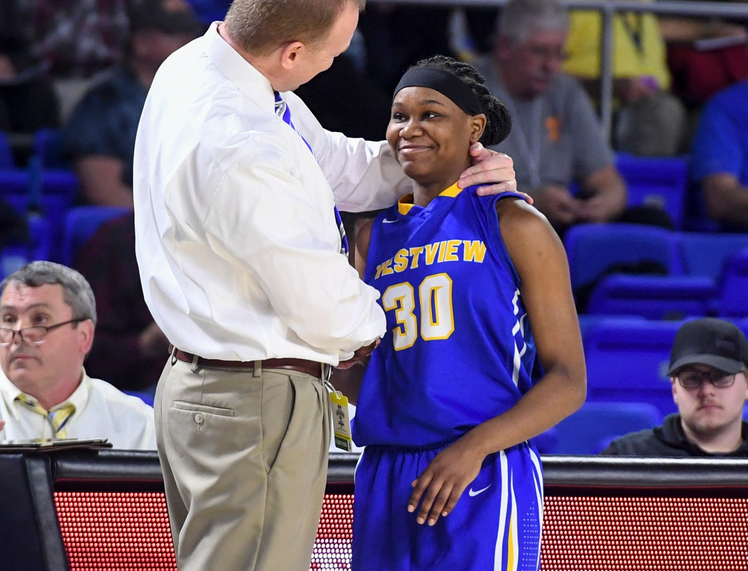 Westview's head coach Brian Haskins greets Westview's Tiara Yancey (30) as she heads to the bench after shooting free throws during their Class A semifinal game, Friday, March 8, 2019, in Murfreesboro. Westview defeated Marshall County, 46-37.