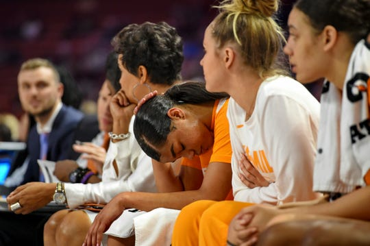 Tennessee's Evina Westbrook, center, bows her head during the last minutes of a women's Southeastern Conference NCAA college basketball tournament game against Mississippi State Friday, March 8, 2019, in Greenville, S.C.