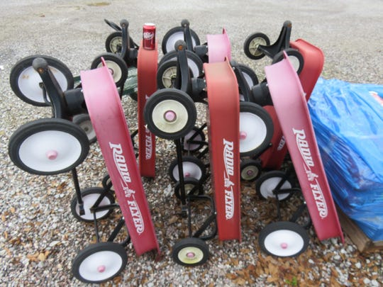 Radio Flyer wagons waiting to be used by customers carrying plants.
