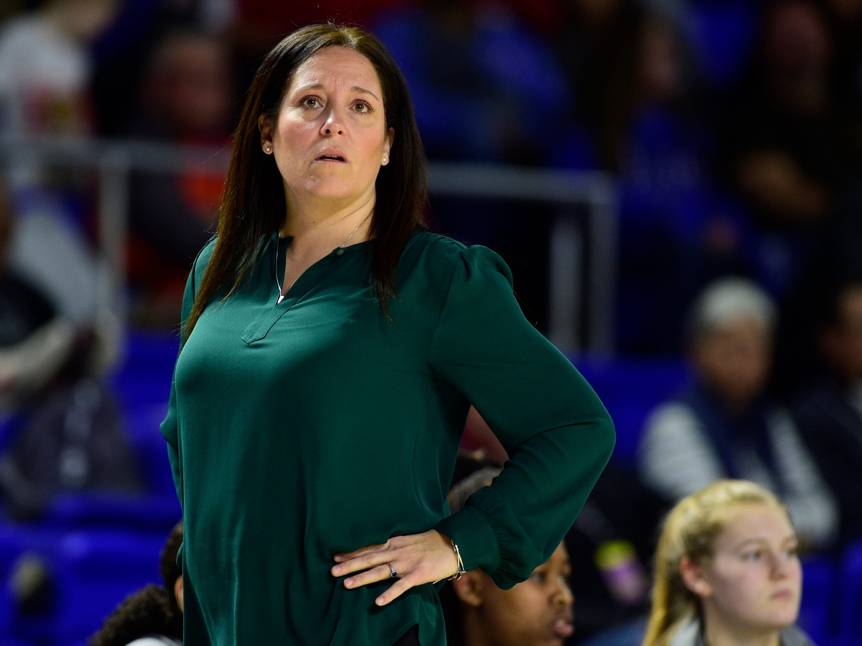 Oak Ridge Head Coach Paige Redman watches the game during a game between Oak Ridge and Bradley Central at the TSSAA girls state tournament at the Murphy Center in Murfreesboro, Tennessee on Friday, March 8, 2019.